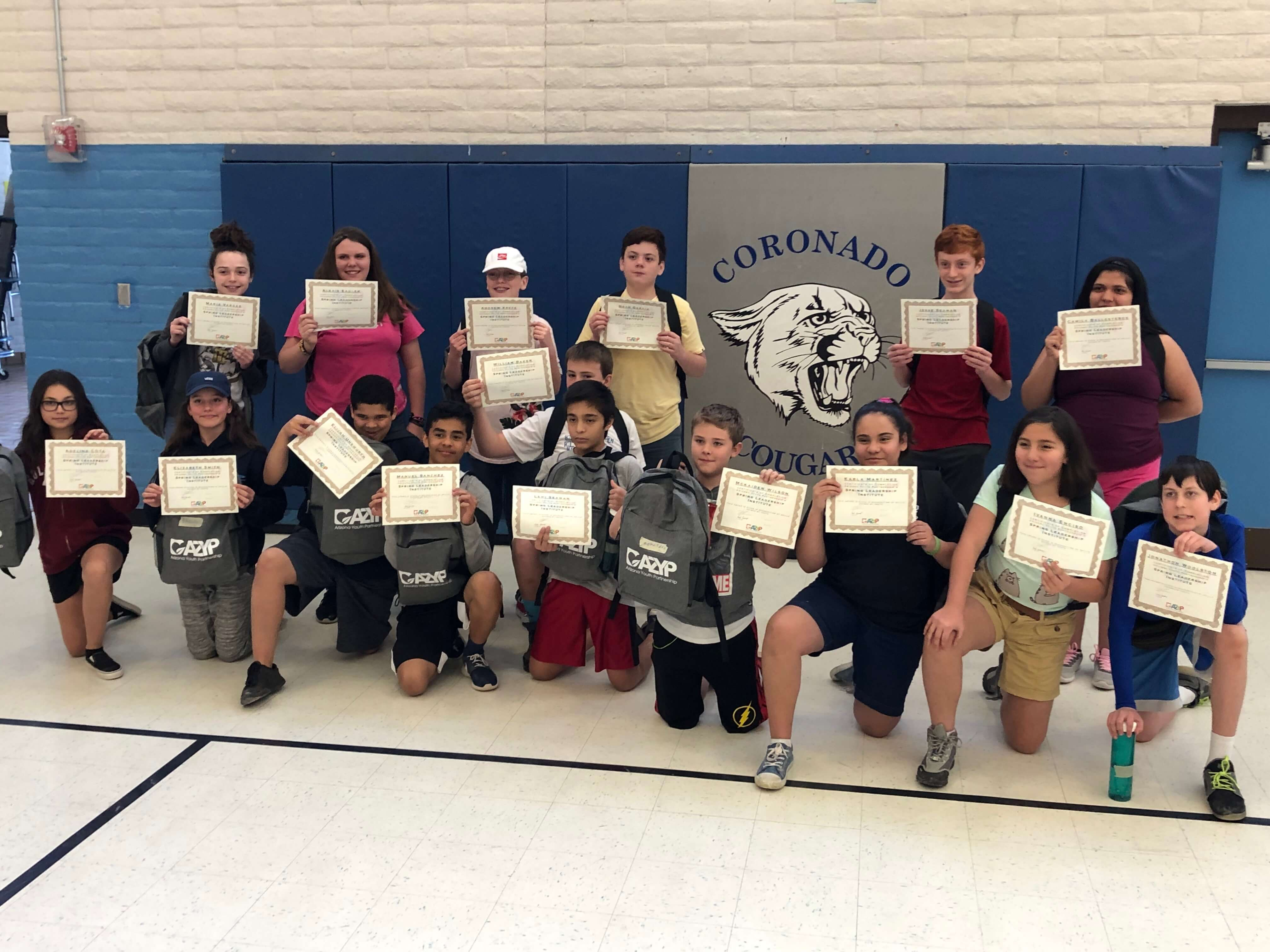 students holding up certificates
